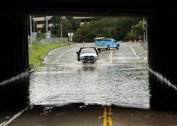 A traffic control vehicle transits a flooded underpass in San Rafael, Calif., on Sunday, Dec. 2, 2012. Days of heavy rains have left the region saturated and several rivers are expected to flood their banks Sunday afternoon.