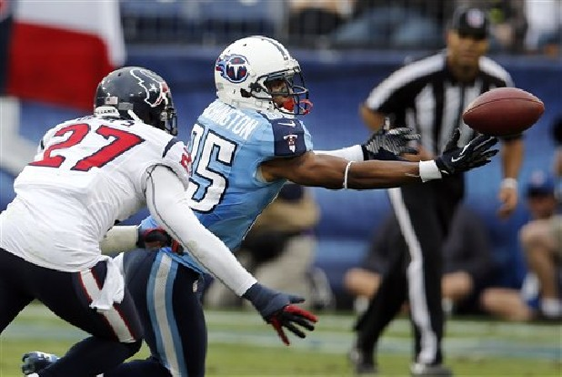 Tennessee Titans wide receiver Nate Washington (85) cannot hold on to a pass as he is defended by Houston Texans defensive back Quintin Demps (27) in the fourth quarter of an NFL football game on Sunday, Dec. 2, 2012, in Nashville, Tenn.