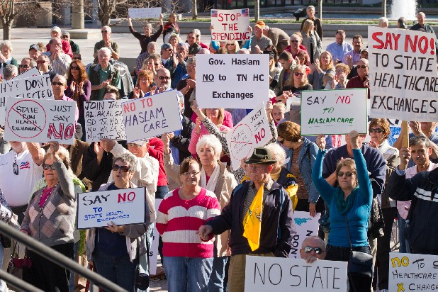 Protesters participate in a tea party rally in Nashville on Wednesday to oppose Tennessee creating a state-run insurance exchange under the federal health care law. Republican Gov. Bill Haslam has said he wants to have a more complete understanding of the costs to the states of a state-run marketplace compared with one run by the federal government.