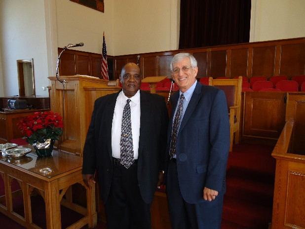 Faith United Baptist pastor Larry Jones, left, and Oak Grove Baptist pastor Paul Crosby talk about a new building for Faith United.