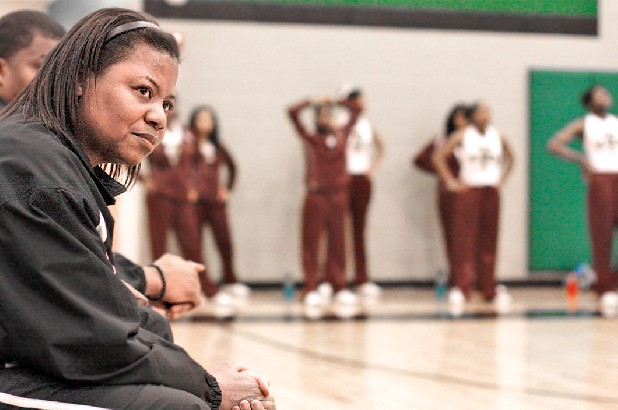 After 13 years as the Tyner girls' basketball coach, Terri Parks still teaches there but helps with the Howard team.