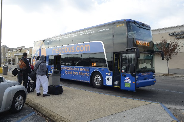 People wait to board the Megabus Wednesday at the Eastgate Town Center.