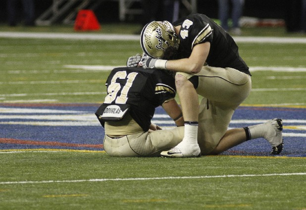 Calhoun's Hunter Padgett, No. 61, and Sebastian Willer pause together after Calhoun lost to Jefferson in the Georgia High School Association Class AA state football championship game.