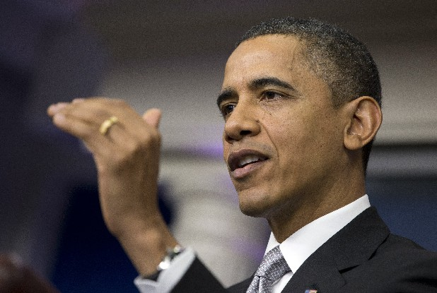 President Barack Obama gestures as he talks about the fiscal cliff negotiations during a news conference in the briefing room of the White House on Wednesday.  Obama also announced that Vice President Joe Biden will lead an administrationwide effort to curb gun violence in response to the Connecticut school shooting.