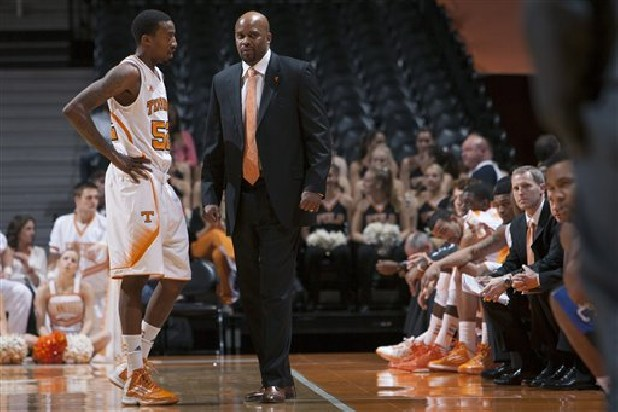 Tennessee coach Cuonzo Martin talks with guard Jordan McRae (52) during the first half of an NCAA college basketball game against Presbyterian at Thompson-Boling Arena in Knoxville, Tenn.