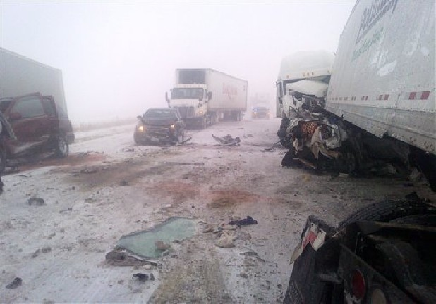This photo provided by the Iowa State Patrol shows the scene of a 25-vehicle pileup that killed three people Thursday north of Des Moines, Iowa. Authorities said drivers were blinded by blowing snow and didn't see vehicles that had slowed or stopped on Interstate 80 about 60 miles north of Des Moines. A chain reaction of crashes involving semitrailers and passenger cars closed down a section of the highway.