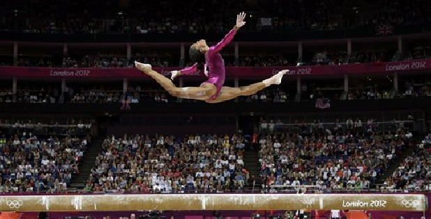 Gabrielle Douglas, of the United States, performsAug. 2, on the balance beam during the artistic gymnastics women's individual all-around competition at the 2012 Summer Olympics in London. Douglas, who became the first African-American gymnast to claim gymnastics' biggest prize — the all-around Olympic title— is The Associated Press' 2012 female athlete of the year.