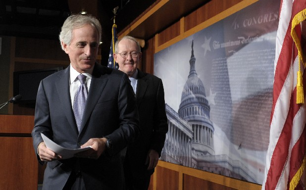 Sen. Bob Corker, R-Tenn., left, and Sen. Lamar Alexander, R-Tenn.,leave a news conference where they discussed the fiscal cliff, Friday on Capitol Hill in Washington.