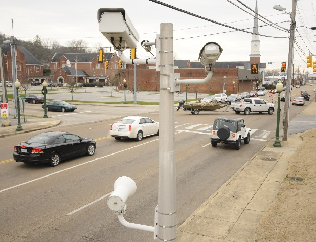 Southbound Dayton Boulevard traffic waits as motorists turn left from Ashland Terrace on Friday. The traffic cameras in Red Bank are due to go dark on Jan. 19. Some local leaders say the cameras made streets safer, but business owners say they drove away customers.