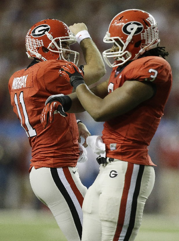 Georgia quarterback Aaron Murray (11) and running back Todd Gurley (3) had their moments in the SEC title game but lost to Alabama. Their opponent today, Nebraska, lost in the Big Ten championship game.