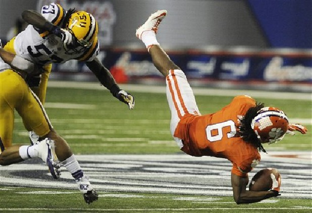 Clemson wide receiver DeAndre Hopkins (6) makes a catch as LSU linebacker Lamin Barrow (57) defends during the second half of the Chick-fil-A Bowl NCAA college football game in Atlanta.