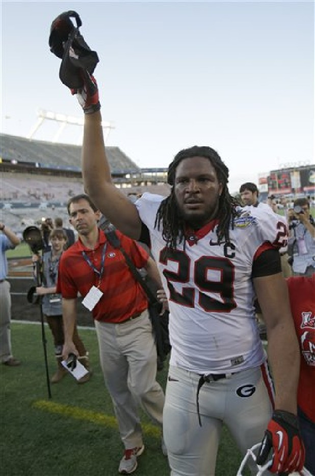 Georgia linebacker Jarvis Jones tips his hat to fans as he leaves the field after defeating Nebraska 45-31 in the Capital One Bowl NCAA football game in Orlando, Fla.