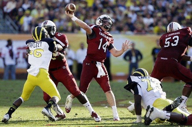 South Carolina quarterback Connor Shaw (14) throws a touchdown pass to wide receiver Ace Sanders during the second half of the Outback Bowl NCAA college football game against Michigan, Tuesday, Jan. 1, 2013, in Tampa, Fla. South Carolina won 33-28. (AP Photo/Chris O'Meara)