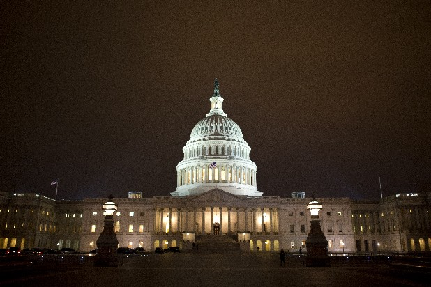 The lights of the U.S. Capitol remain lit into the night.