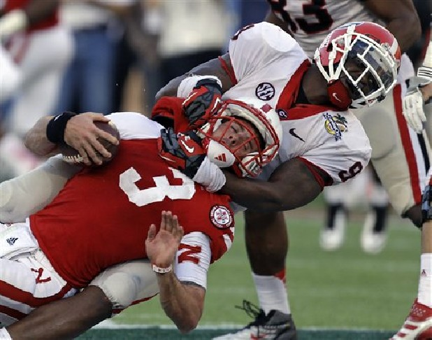 Georgia linebacker Alec Ogletree (9) sacks Nebraska quarterback Taylor Martinez (3) on a fourth and nine play late in the fourth quarter of the Capital One Bowl NCAA college football game in Orlando, Fla.