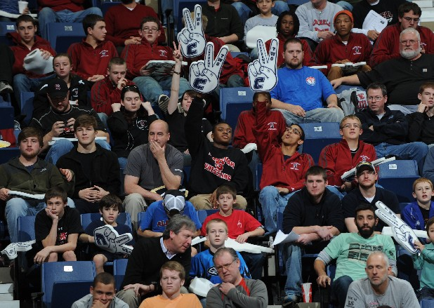 Fans cheer during the Southern Scuffle wrestling tournament finals.