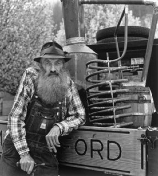 "This photograph of moonshiner Marvin ""Popcorn"" Sutton is part of the traveling exhibition ""Vanishing Appalachia"" by photographer Don Dudenbostel and media producer Tom Jester. The exhibition is on loan to the McMinn County Living Heritage Museum in Athens, Tenn. this month from the Museum of East Tennessee History in Knoxville."