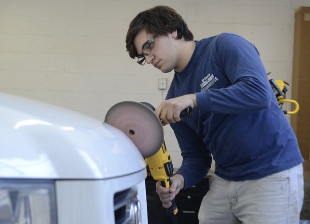 Beau Gilliland works on a vehicle at Chattanooga Detail, the business he operates in Red Bank with co-owner David Hopkins.