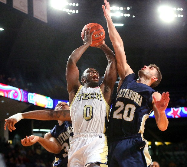 Georgia Tech guard Mfon Udofia (0) is fouled by Chattanooga forward Drazen Zlovaric (20) and sent to the free throw line during second-half NCAA college basketball game action at McCamish Pavilion in Atlanta, Wednesday, Jan. 2, 2013. Georgia Tech won 74-58.