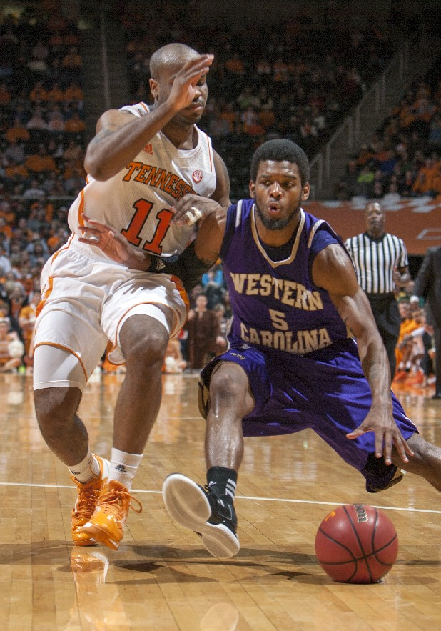 Western Carolina guard Trey Sumler (5) works against Tennessee guard Trae Golden (11) during the second half of an NCAA college basketball game Friday, Dec. 21, 2012, in Knoxville, Tenn. (AP Photo/Knoxville News Sentinel, Adam Brimer)