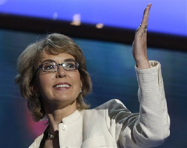 Former Arizona Rep. Gabrielle Giffords blows a kiss Sept. 6, 2012, after reciting the Pledge of Allegiance at the Democratic National Convention in Charlotte, N.C. A spokesman on Thursday said Connecticut's lieutenant governor has been invited to attend a meeting between Giffords and families of the victims of the deadly Newtown elementary school shooting.