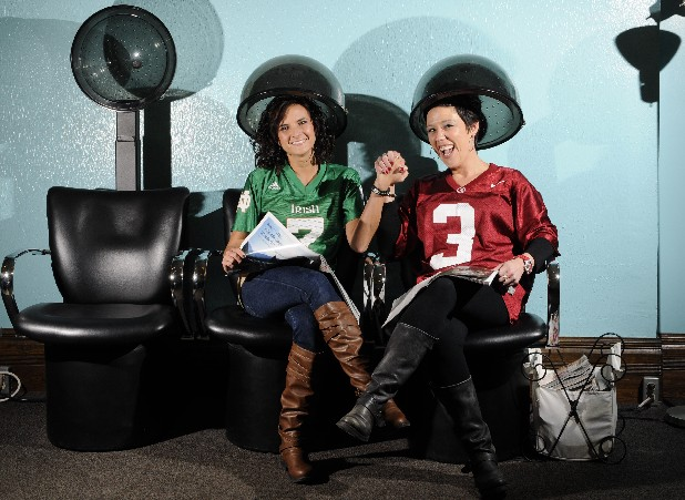 At Southside Salon, stylists Jennifer Ward, left, a Notre Dame fan, and Marissa Shrum, a diehard Alabama supporter, nurse a friendly rivalry for college football's BCS National Championship game tonight.