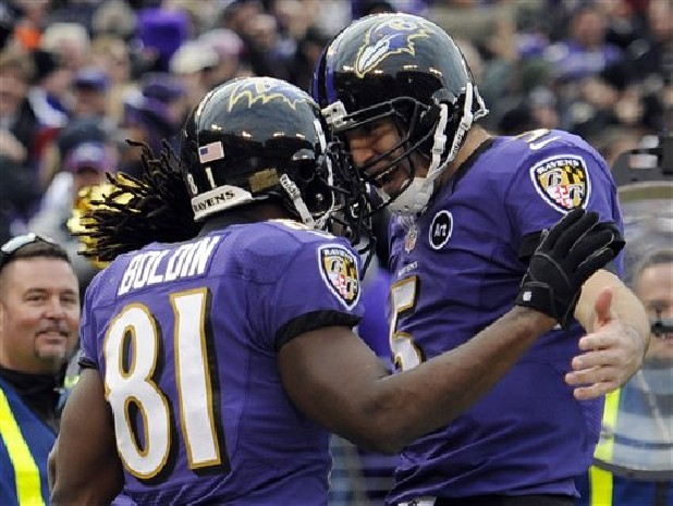 Baltimore Ravens wide receiver Anquan Boldin (81) celebrates his touchdown catch Sunday with quarterback Joe Flacco (5) during the second half of an NFL wild card playoff game against the Indianapolis Colts in Baltimore.