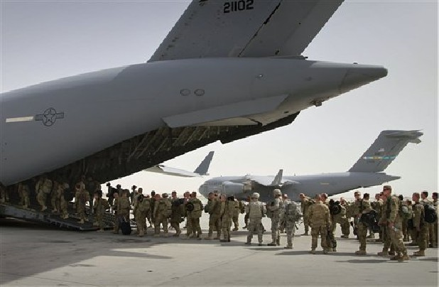 U.S. soldiers board a U.S. military plane as they leave Afghanistan at the U.S. base in Bagram north of Kabul.