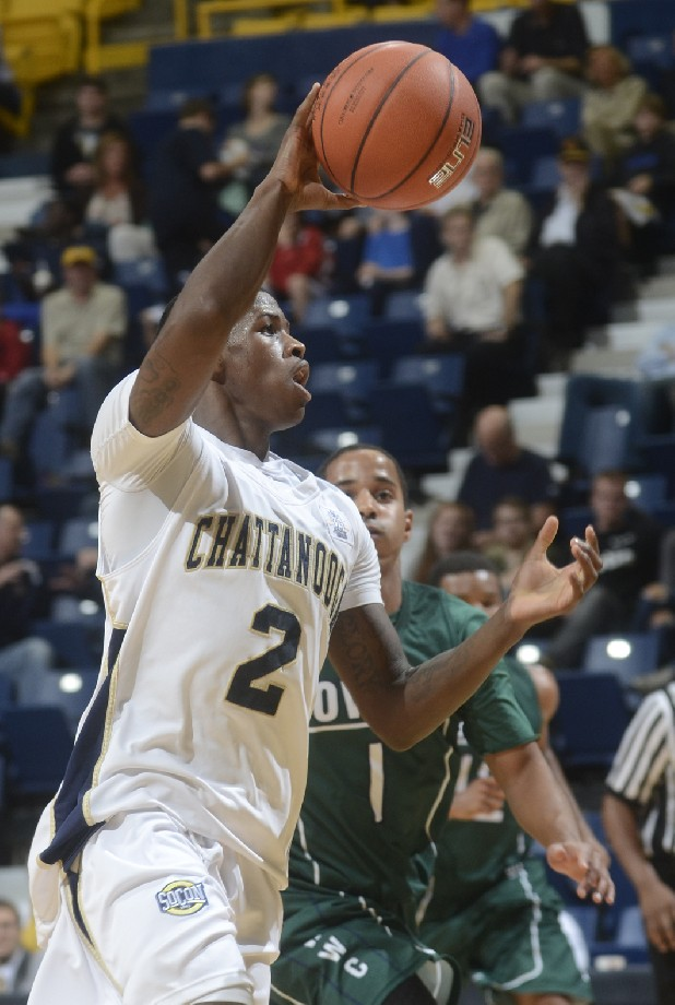 UTC's Dontay Hampton controls the ball while being guarded by Warren Wilson's Devin Steptoe.