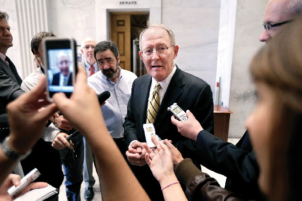 "Sen. Lamar Alexander, R-Tenn., speaks to reporters on Wednesday in Nashville. Alexander is proposing a ""grand swap"" in which the federal government would take over all responsibility for Medicaid and the states would gain all control over education."