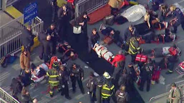 This aerial photo provided by WABC News Channel 7 shows emergency personnel at the scene of a ferry crash in Lower Manhattan, Wednesday, Jan. 9, 2013, in New York. The Fire Department says about 17 people were injured when a ferry from New Jersey struck a dock during rush hour.