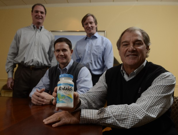Chattem, Inc., CEO Zan Guerry, right, holds a bottle of Rolaids as he is photographed with Blair Ramey, senior vice president of corporate development and media, executive vice president Robert Long and executive vice president John Stroud in the company's corporate office building in St. Elmo.