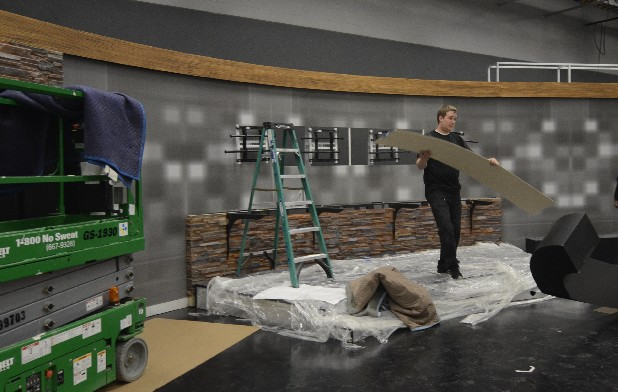 Kolby Brown works on the new set for WTVC, which is being redone to accomodate the wider view of high-definition TV.