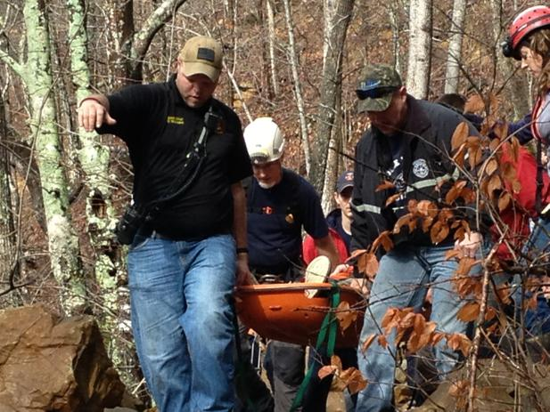 Rescuers carry an injured hiker at the Pocket Wilderness near Soddy-Daisy. The 19-year-old Nashville man was hiking with friends when he fell down a bluff, hit his head on a rock and landed in a creek. He is listed in critical condition at Erlanger, authorities said.