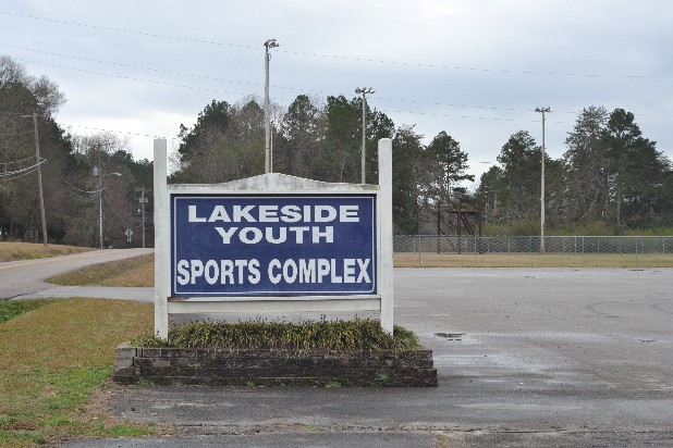 The entrance sign is seen Sunday afternoon at the Lakeside Youth Sports Complex off Highway 58, where a man was fatally shot Saturday night.