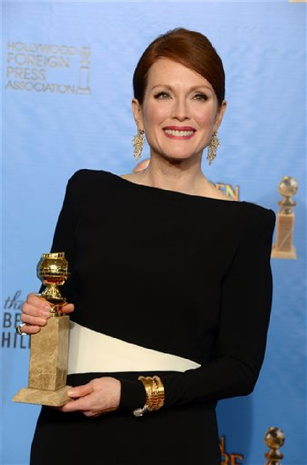 "Julianne Moore poses Sunday with the award for best miniseries or motion picture made for television for ""Game Change"" backstage at the 70th Annual Golden Globe Awards at the Beverly Hilton Hotel in Beverly Hills, Calif."