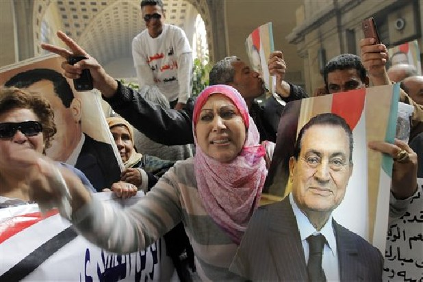Egyptians supporters of ousted former President Hosni Mubarak celebrate Sunday an appeal granted by a court, in Cairo, Egypt. A court granted Hosni Mubarak's appeal of his life sentence in a hearing, ordering a retrial of the ousted Egyptian president on charges that he failed to prevent the killing of hundreds of protesters during the uprising that toppled his regime nearly two years ago.