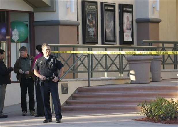 Police investigate a shooting at the Reading Cinemas in San Diego on Saturday. Police shot and critically wounded a man suspected of chasing his girlfriend with a handgun after they found him hiding inside the movie theater. It was the second shooting at a San Diego County movie theater in as many days.