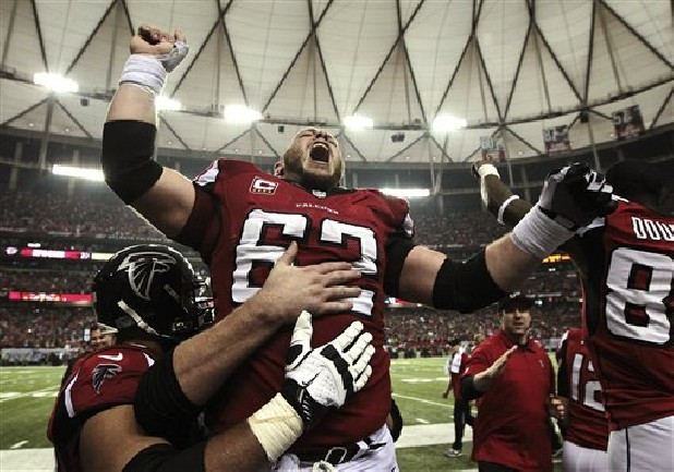 Atlanta Falcons center Todd McClure (62) celebrates Sunday on the sidelines following kicker Matt Bryant's winning 49-yard field goal against the Seattle Seahawks during the fourth quarter of their NFC divisional playoff NFL game in Atlanta. The Falcons won 30-28.
