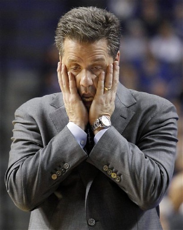 Kentucky coach John Calipari reacts to his team's play during the second half of an NCAA college basketball game against Tennessee at Rupp Arena in Lexington, Ky.