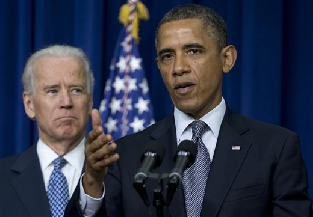 President Barack Obama, accompanied by Vice President Joe Biden, gestures Wedneday as he talks about proposals to reduce gun violence.