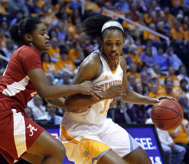 Tennessee's Bashaara Graves, right, works against Alabama's Bri Huchen in the first half Sunday. Graves had a team-high 19 points and eight rebounds as the Lady Vols won 96-69.