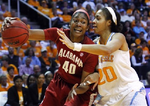 Alabama's Kaneisha Horn (40) drives against Tennessee's Isabelle Harrison (20) in the first half of an NCAA college basketball game Sunday in Knoxville. Tennessee won 96-69.