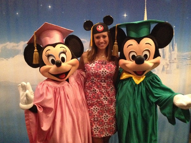 Michelle Brooks received a certificate from the Disney College Program from Minnie, left, and Mickey Mouse.