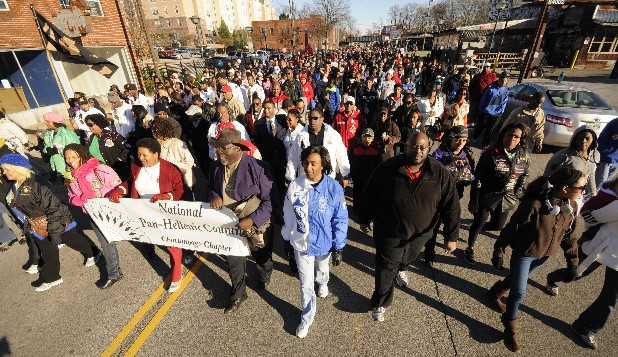 Hundreds turn out Monday and march the annual walk to the Tivoli Theatre in honor of Dr. Martin Luther King Jr.