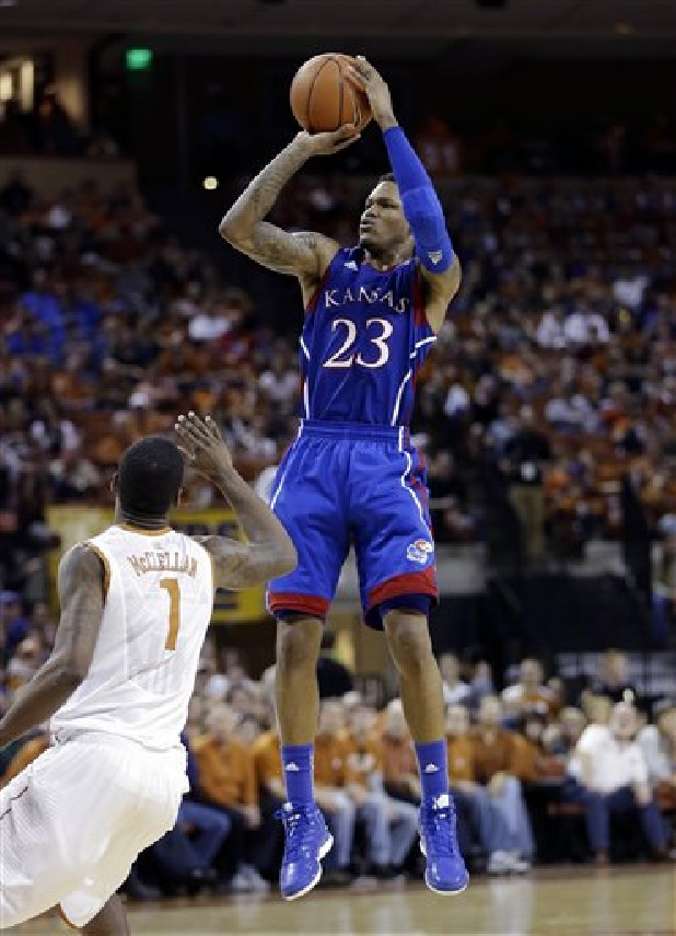Kansas' Ben McLemore (23) shoots over Texas' Sheldon McClellan (1) during the second half of an NCAA college basketball game in Austin, Texas.