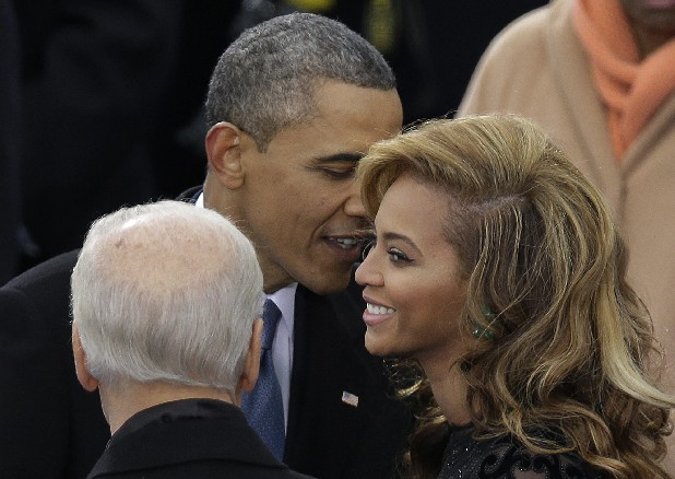 President Barack Obama talks to Beyonce before she sings the National Anthem at his ceremonial swearing-in at the U.S. Capitol during the 57th Presidential Inauguration in Washington on Monday.