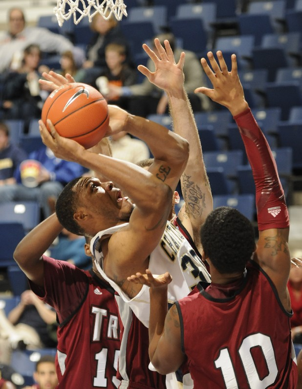 Chattanooga's Zaccheus Mason forces a shot after a rebound at a game at McKenzie Arena.