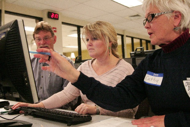 Cathy Barham, right, helps Wendy and Jim Thompson fill out the federal financial aid application for their daughter Bailey at the UTC University Center during College Goal Sunday at the University Center.