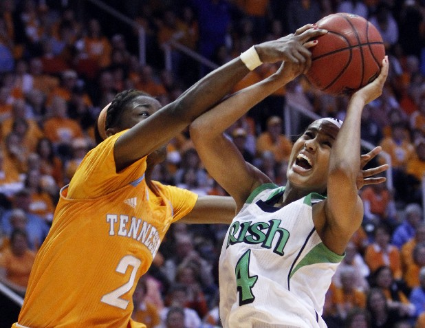 Notre Dame's Skylar Diggins (4) is fouled by Tennessee forward Jasmine Jones in Monday's game in Knoxville. Diggins scored 33 points as the Irish won 77-67.